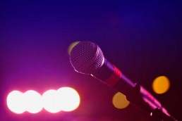 A close-up of a microphone awaiting someone to make a wedding or after-dinner speech written by a professional speech writer