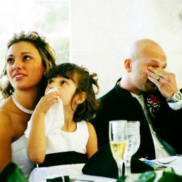 A tearful bride and groom listening to a great Father of The Bride speech
