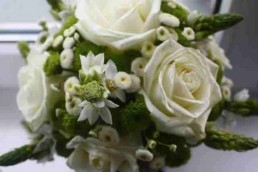 A bouquet of white roses representing a wedding speech writing service from a professional speech writer