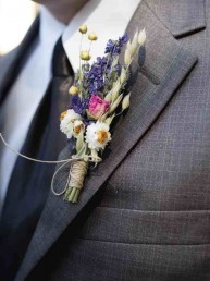 Close-up of Best Man with colourful flowers in his lapel as an image for the Best Man speech landing page