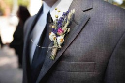 Best Man with flowers in button