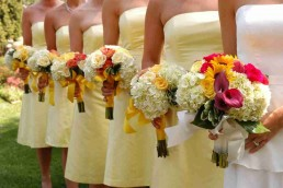 Maid of Honour and bridesmaids standing in a row
